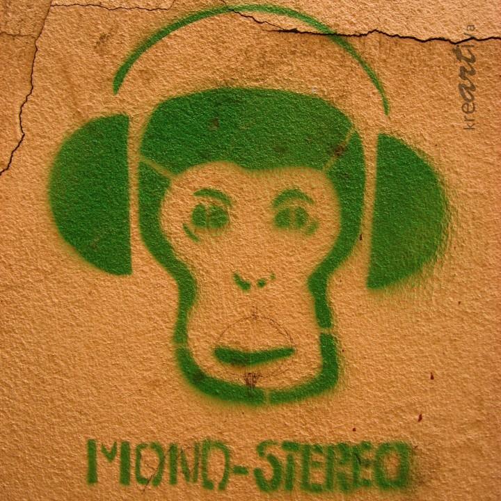 Mono-Stereo, ape with headphones.
